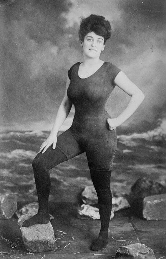 Retro photo of a girl in first fitted one-piece bathing costume, 1907. Model was arrested for indecency