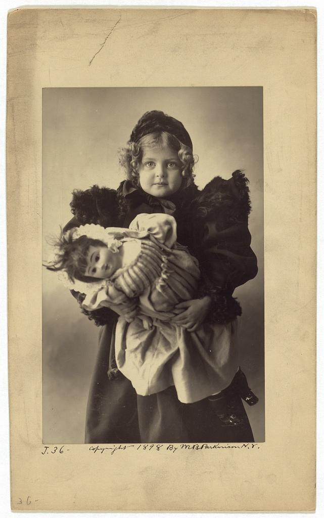 girl with doll 1898