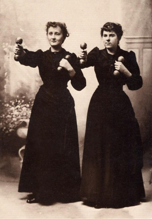 Retro photo of two women having Weight Training