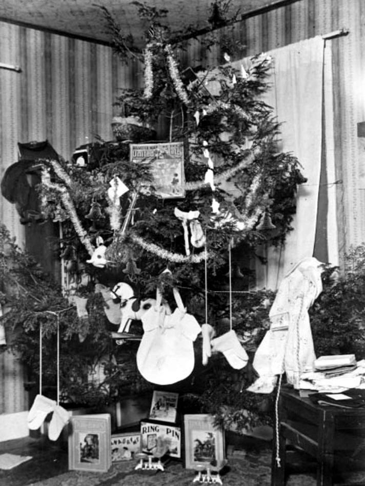 Christmas tree with presents on it.