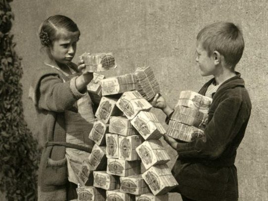 Germany, 1923. Hyperinflation. Kids are playing with money packs, because toy blocks are too expensive