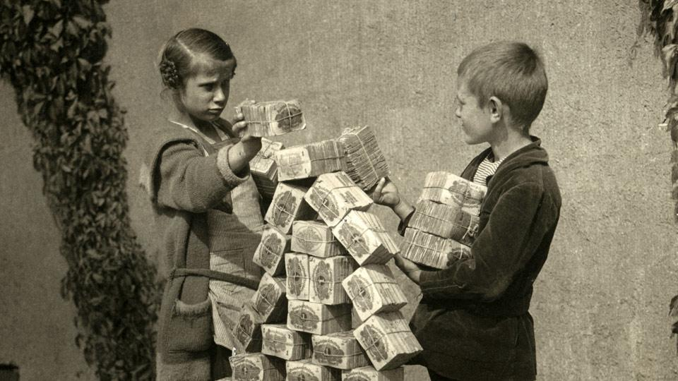 Old photo of kids playing with money packs