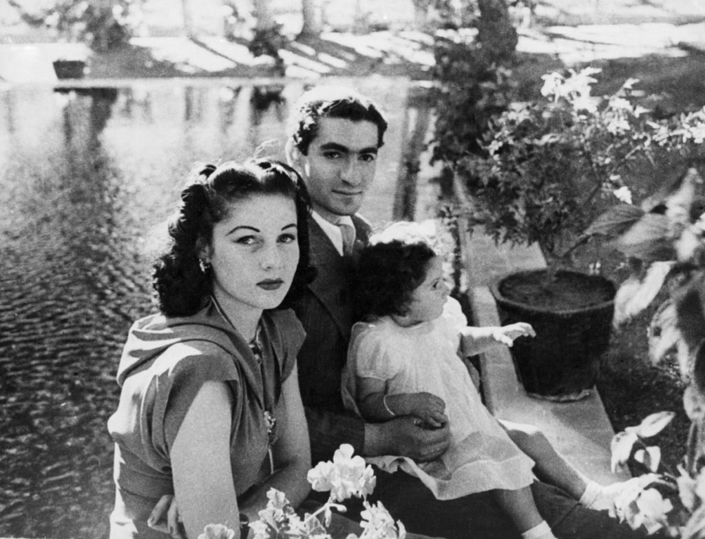old photo of Shah Muhammed Reza Pahlevi, his wife, Queen Fawzia, and the little Princess Shahnaz