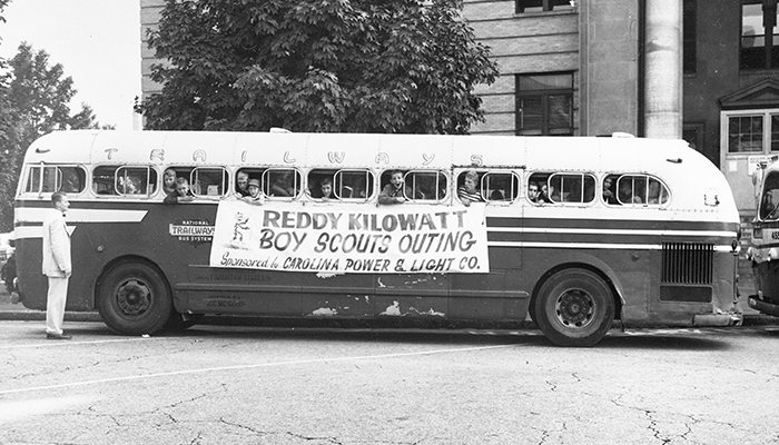 Retro photo (1950s) bus with boy scout