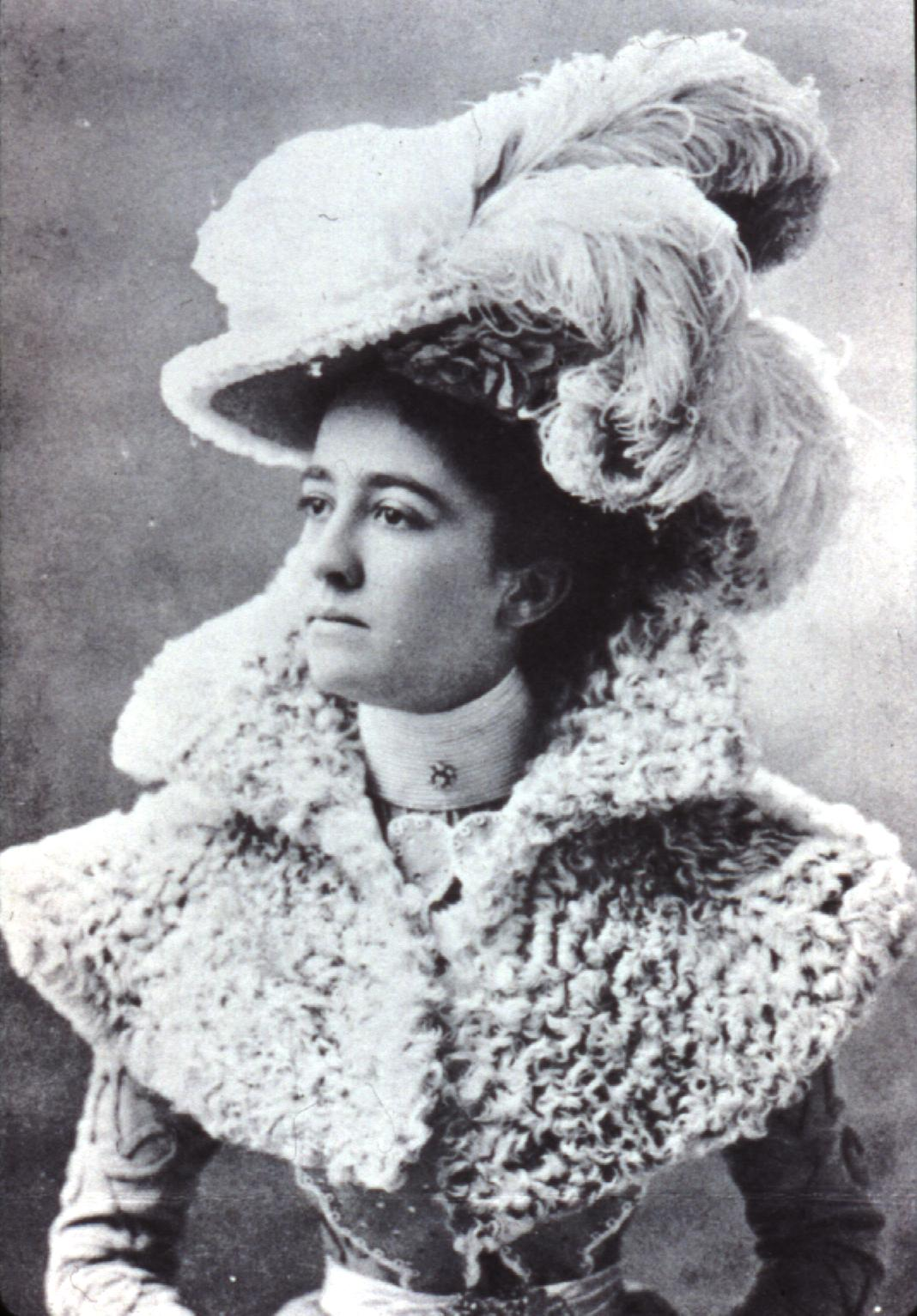vintage photo of a woman in a hat with plumee