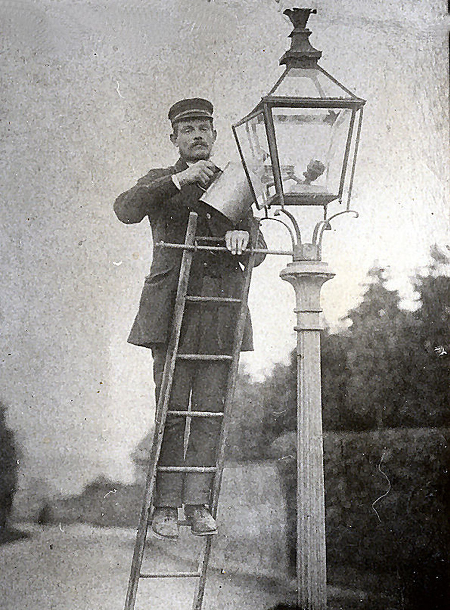 vintage photo of a lamplighter