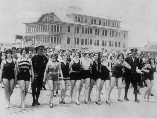 Women arrested on a New Jersey beach due to their indecent swimsuits in 1920.