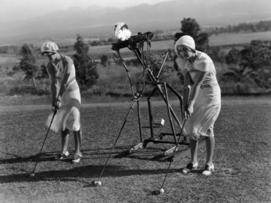 Girls playing golf with a robotic instructor, 1925