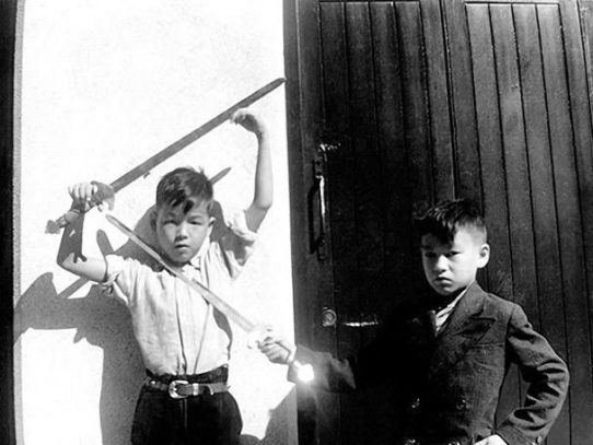 Young Bruce Lee playing with his brother, Hong Kong, 1940s