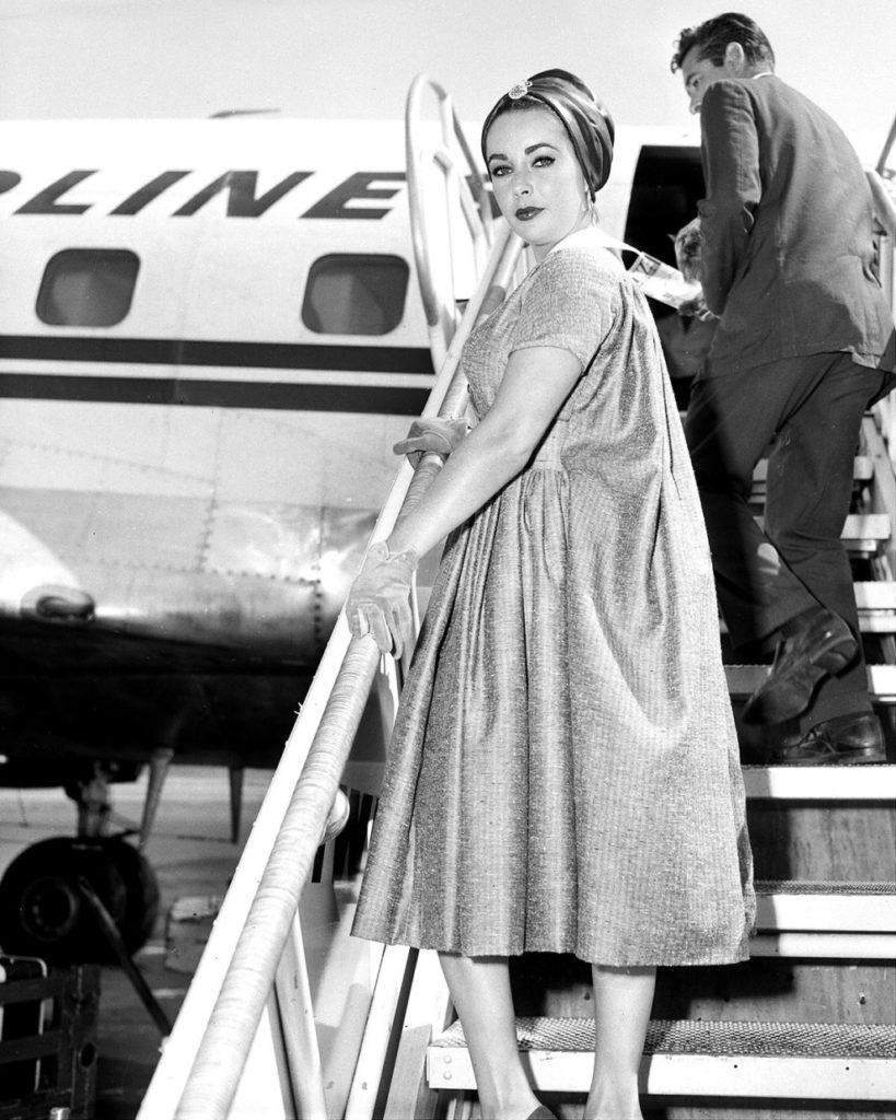 vintage celeb photos Elizabeth Taylor boards a plane  for Hollywood in 1958