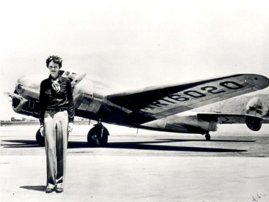 Amelia Earhart in front of the Lockheed Electra in which she disappeared in July 1937
