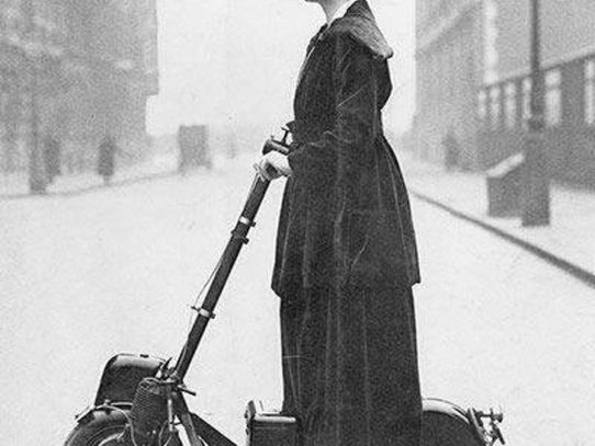 A woman riding an Autoped, New York, 1916