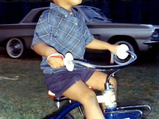 Barack Obama riding a tricycle, circa 1965