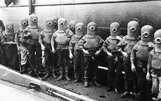 The crew of a submarine in diving suits, 1908