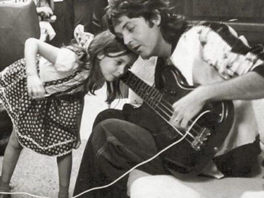 Little Mary McCartney listening to her Dad