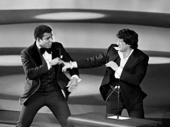 Muhammad Ali and Sylvester Stallone pretending to fight onstage at the 1977 Oscars