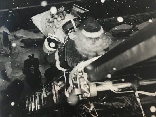Santa climbing the ladder up to Gimbel's Toyland, 1947