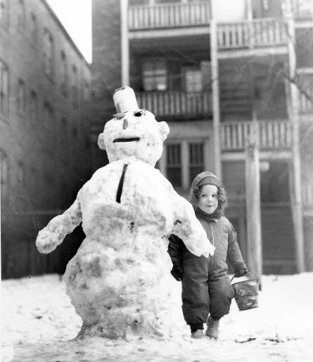 A girl with a snowman, Chicago, circa 1940s