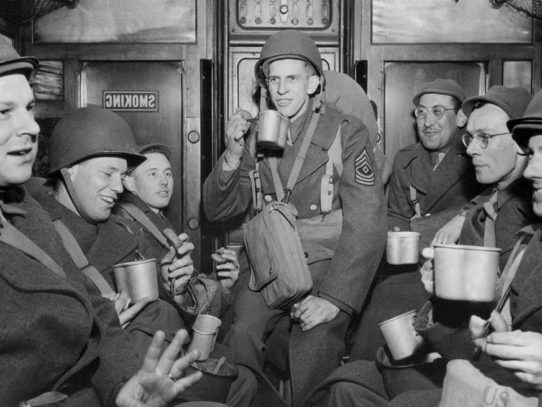 American soldiers, drinking coffee with donuts on a troop train, England, 1944