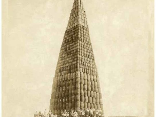 Giant tower of barrels that have to be burned during Prohibition, 1924