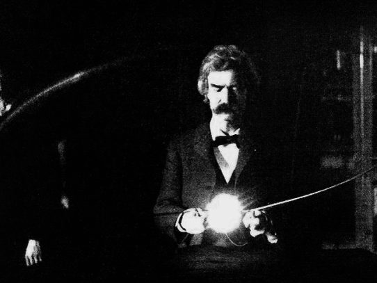 Mark Twain holding an experimental electronic lamp in Tesla's lab, 1894