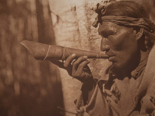 The Cree Moose Hunter with a carved horn, 1926