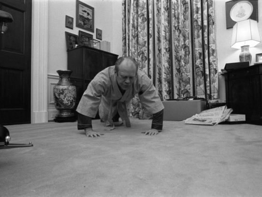 President Ford doing push ups, White House, 1975