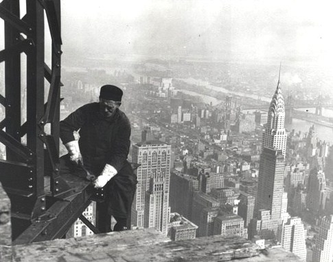 A workman on the framework of the Empire State Building, 1930