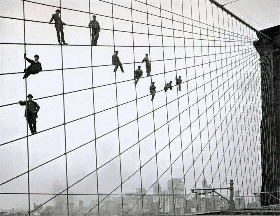 Workers on the cables of the Brooklyn Bridge, October 1914