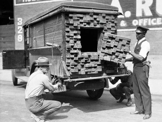 "Federal agents inspect a ""lumber truck"" during prohibition, Los Angeles, 1926"