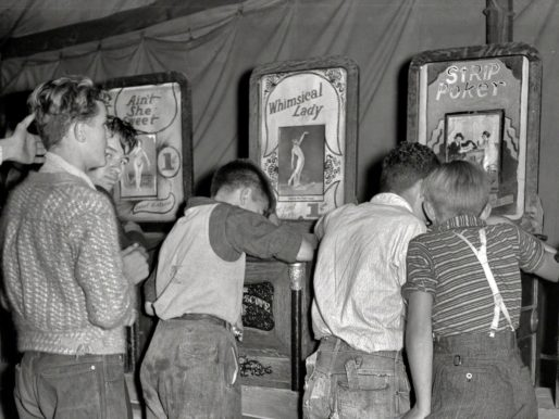 Boys looking at naked lady penny arcade machines, Granville,West Virginia, 1938