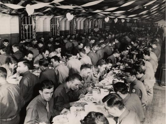 Soldiers eating Thanksgiving dinner, Missouri, 1944.