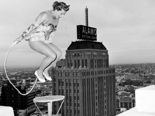 Betty Fox skips rope on a ledge 400 feet above the street, 1958