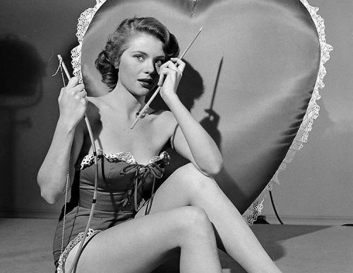 Peggie Castle dressed as Cupid, 1950