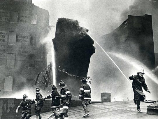 Firefighters trying to escape a falling wall during a fire in the Bronx, 1962