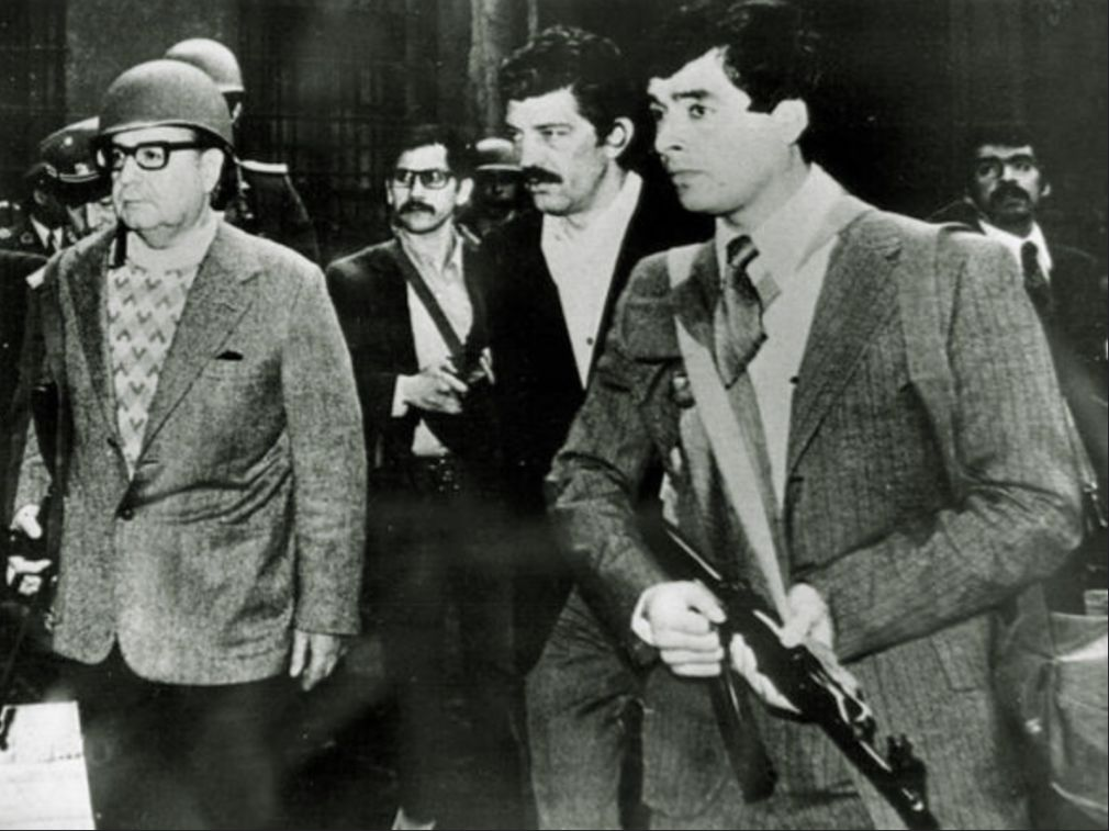 Allende escorted by loyal guards