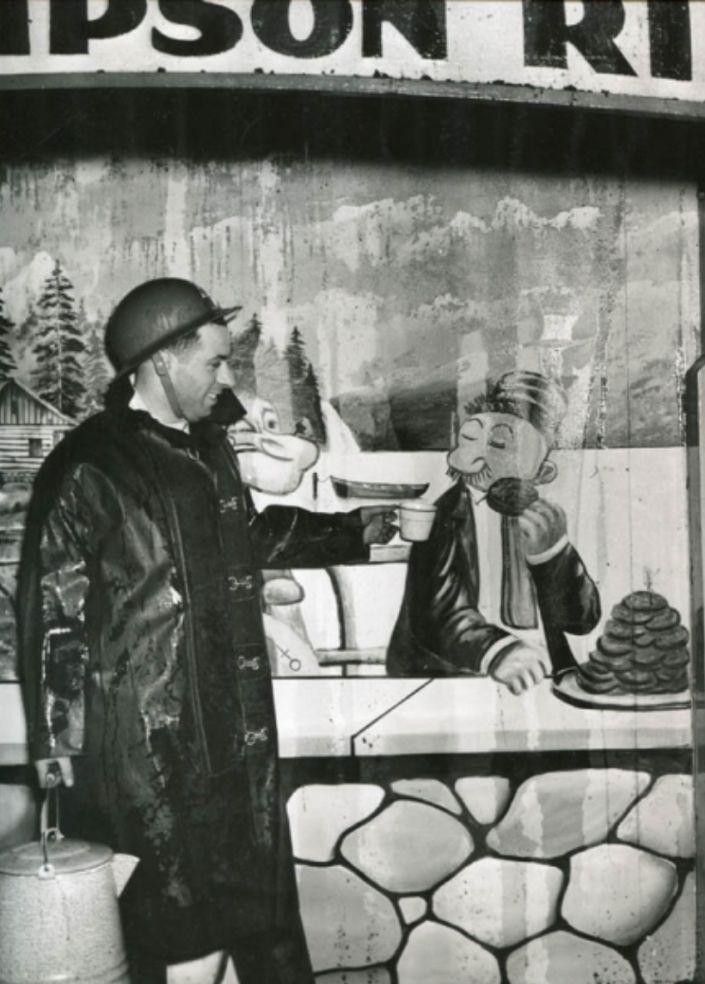 fireman with cup of tea, Weegee photos