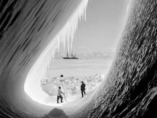 Scientists looking at Terra Nova from ice grotto in Antarctica