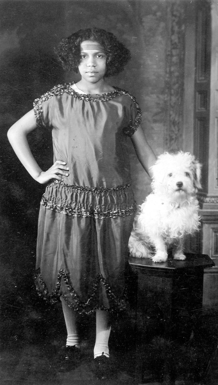 Young girl with a dog, VanDerZee photos