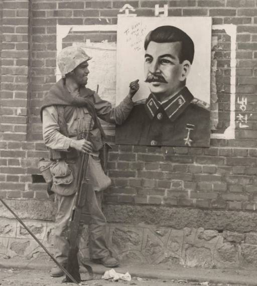 US soldier with a portrait of Stalin