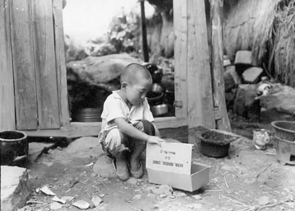 Young boy looking for food Korean war