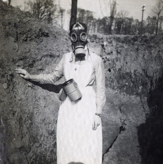 History photo of a nurse wearing a gas mask, 1918
