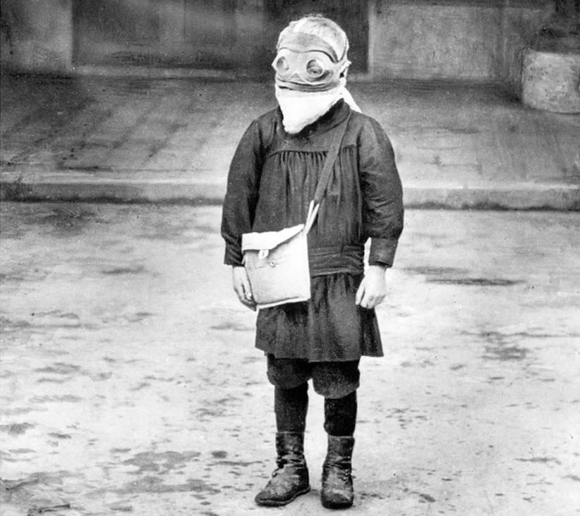 A young schoolboy of Reims wearing his gas mask, France, January 1916