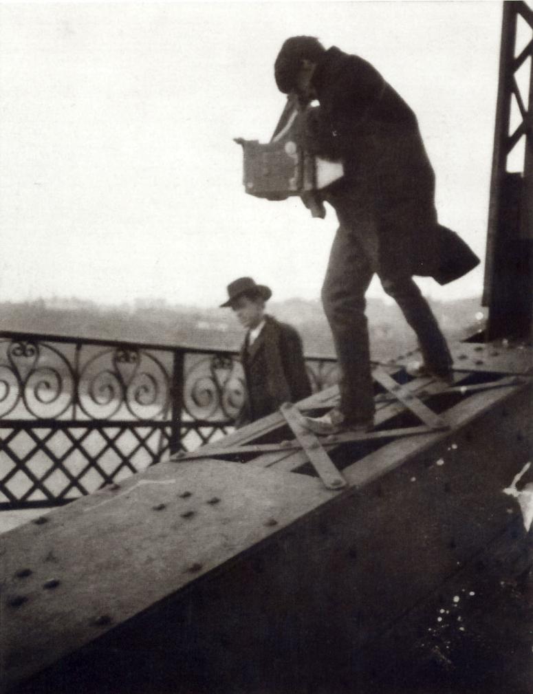 Alfred Stieglitz taking photo