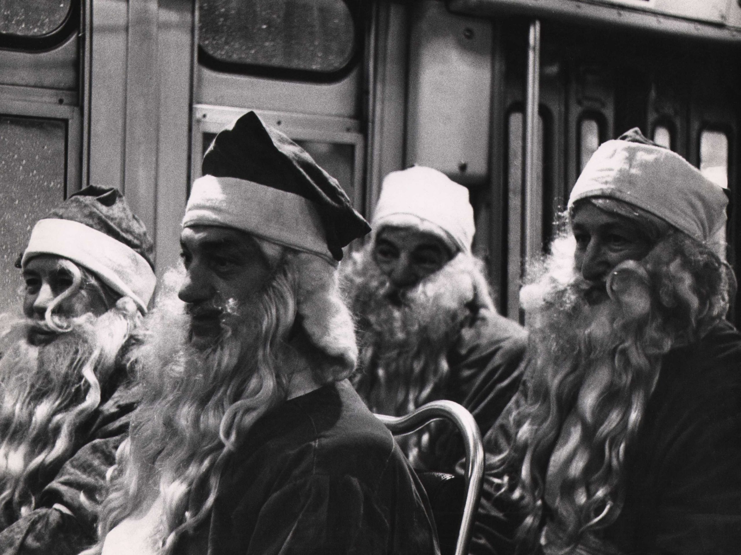 Bedrich Grunzweig, Four Santas in a New York Bus, Christmas, 1954