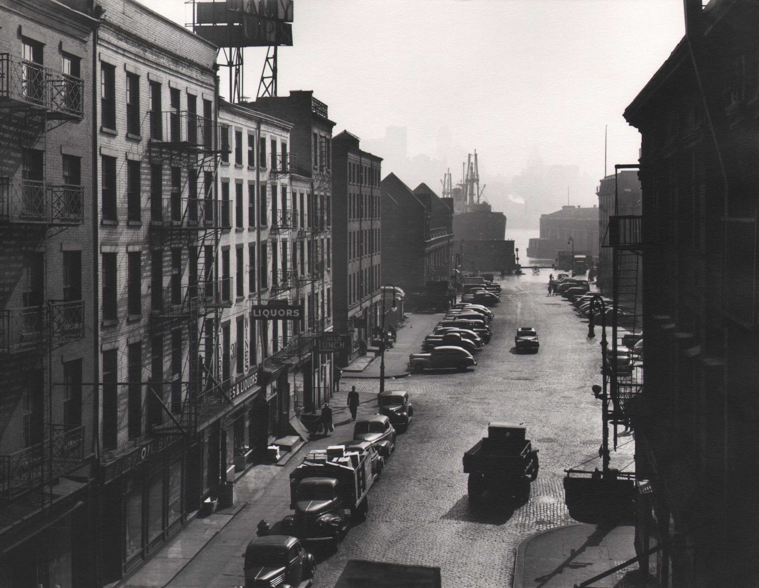 Esther Bubley, New York Harbor- View looking East on Fulton Street from Third Avenue El platform, 1946