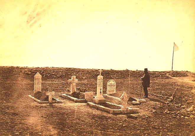 The tombs of the generals on Cathcart's Hill: a man standing at the grave of Brigadier General Thomas Leigh Goldie, who was killed in action at the Battle of Inkerman.