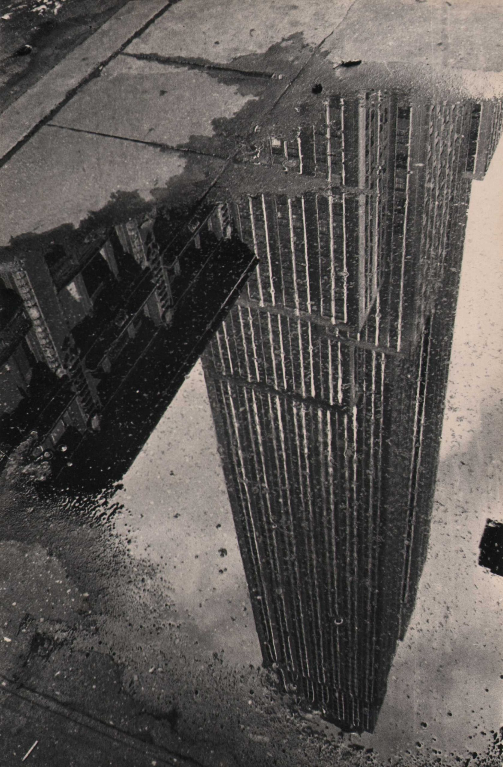 Fritz Neugass, Reflections- Empire State in a Rain Puddle, c. 1948
