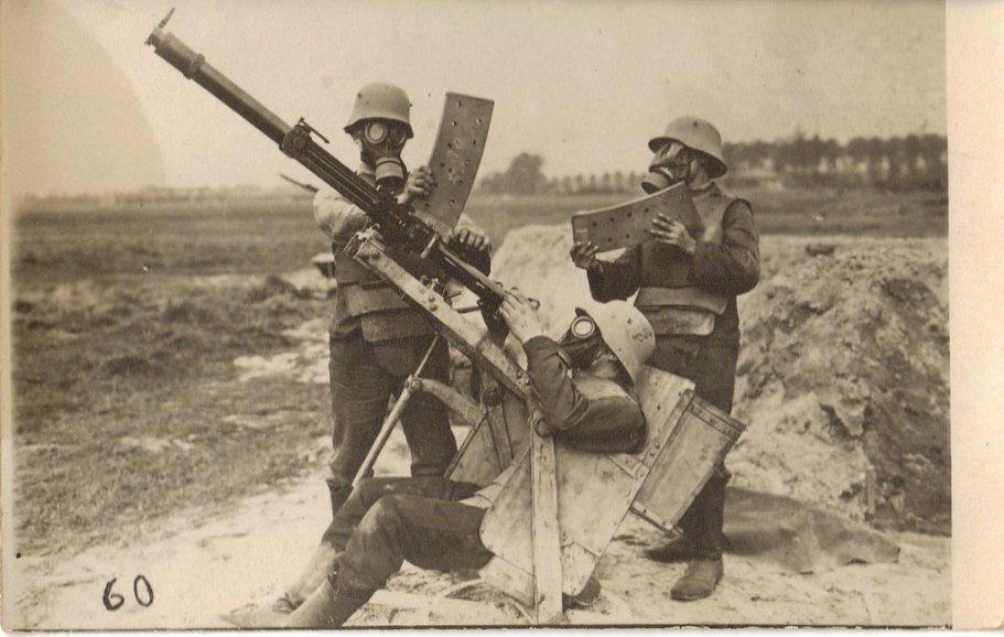 German machine gun crew wearing Grabenpanzer and gas masks man a Becker-Flugzeugkanone repurposed as an anti aircraft gun, 1916