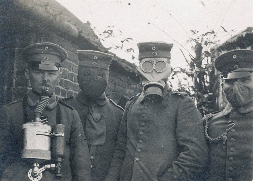 German soldiers wearing four different types of gas masks that were used in the early years of World War 1, c. 1916